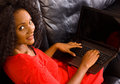Young woman with laptop computer a beautiful african american at home her Royalty Free Stock Photos