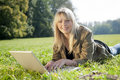 Young woman with laptop on a meadow Royalty Free Stock Photo