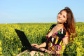 Young woman with laptop outdoor Stock Photography