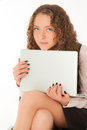 Young woman with laptop sitting on the chair Royalty Free Stock Photo