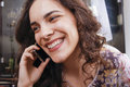 Young woman laughing on a phone Royalty Free Stock Photo