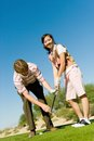 Young Woman Learning Golf From Man Royalty Free Stock Photo