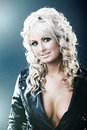 Young woman in leather jackat with cleavage Royalty Free Stock Images