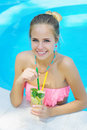 Young woman with lemonade in the pool Royalty Free Stock Photo
