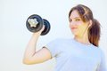 Young woman lifting dumbbell portrait of a beautiful sportive caucasian a with her right arm Stock Photo