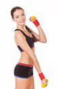 Young woman lifting dumbbells Royalty Free Stock Image