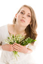 Young woman with lilies of the valley isolated on white background Stock Photo