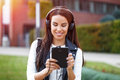 Young woman listening music by headphones outdoor Royalty Free Stock Photo