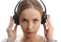 Young woman listening music with headphones on white Stock Image