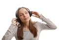 Young woman listening music with headphones on white Stock Photo