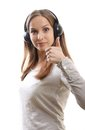 Young woman listening music with headphones on white Royalty Free Stock Images