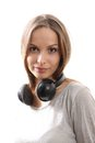 Young woman listening music with headphones on white Stock Photography