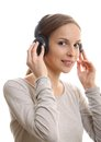 Young woman listening music with headphones on white Royalty Free Stock Image