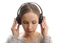 Young woman listening music with headphones on white Royalty Free Stock Photos