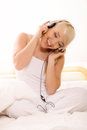 Young woman listening to the music on bed Royalty Free Stock Photography