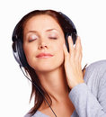 Young woman listening to music with eyes closed Royalty Free Stock Photos