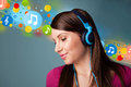 Young woman listening to music with headphones pretty bubbles concept Stock Images