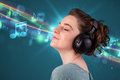 Young woman listening to music with headphones pretty glowing notes and lines concept Royalty Free Stock Photos