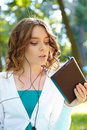 Young woman listens music using tablet pc Stock Photos
