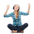 Young woman listeting to music with headphones and technology concept smiling sitting on floor and Stock Photos