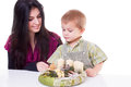 Young woman and little boy with advent wreath women isolated Stock Photos