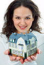 Young woman with little house in hand Royalty Free Stock Photos