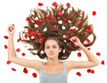 Young woman with long hairs and rose petals Royalty Free Stock Photo