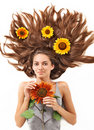 Young woman with long hairs and sunflower Royalty Free Stock Image