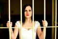 Young woman looking from behind the bars bride Royalty Free Stock Photos