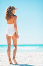 Young woman looking into distance on beach. rear view Royalty Free Stock Photo