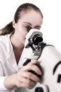 Young woman looking through microscope close up of a Stock Images