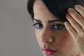 Young woman looking mirror latin herself in the and touching her hair Royalty Free Stock Photos