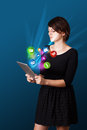 Young woman looking at modern tablet with abstract lights and va business various icons Royalty Free Stock Images