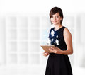 Young woman looking at modern tablet with social icons business Royalty Free Stock Photography