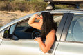 Young woman looking out car window at beach beautiful in her ahead with the hand in forehead near the beach Royalty Free Stock Photos