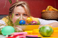 Young woman looking over colorful easter eggs Royalty Free Stock Photos