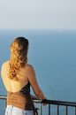 Young woman looking on sea Royalty Free Stock Photo