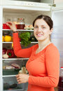 Young woman looking for something in refrigerator Stockfotos