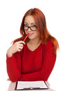 Young woman looking at you over glasses Royalty Free Stock Photos