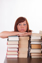 A young woman with lots of books Royalty Free Stock Images