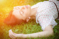 Young woman lying on the grass. Stock Photos