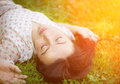 Young woman lying on the grass. Royalty Free Stock Image