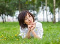 Young woman lying on the grass beautiful smiling with daisy in natural environment Royalty Free Stock Images