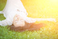 Young woman lying on the grass cute soft focus with shallow depth of field Royalty Free Stock Photo