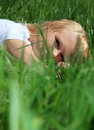 Young woman lying in green grass Stock Photography