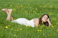Young woman lying in meadow Royalty Free Stock Photography