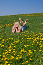 Young woman lying on a meadow Royalty Free Stock Photos