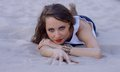 Young woman lying on the sand beach about someone or something to dream facial easy smile life is beautiful Royalty Free Stock Image