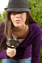 Young woman with magnifier glass and hat looking Royalty Free Stock Photography