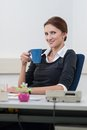 Young woman makes a coffee break Royalty Free Stock Image
